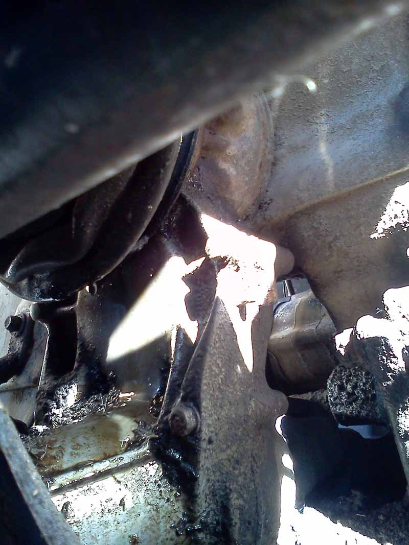 Oil leak from rear of engine where drive shaft connects 1994